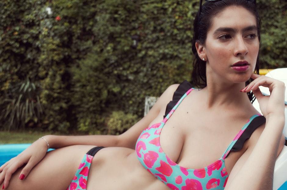 Woman in Teal and Pink Bikini