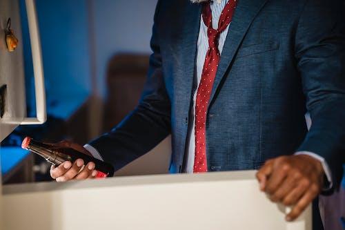 Man in Blue Blazer and Red Necktie
