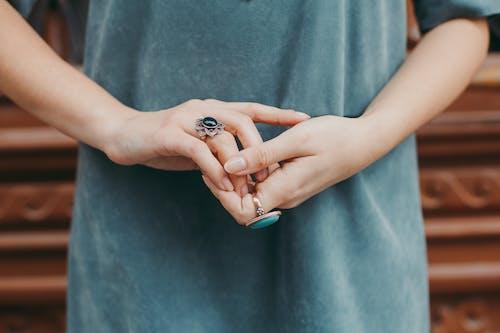 Woman Wearing Blue Gemstone Ring