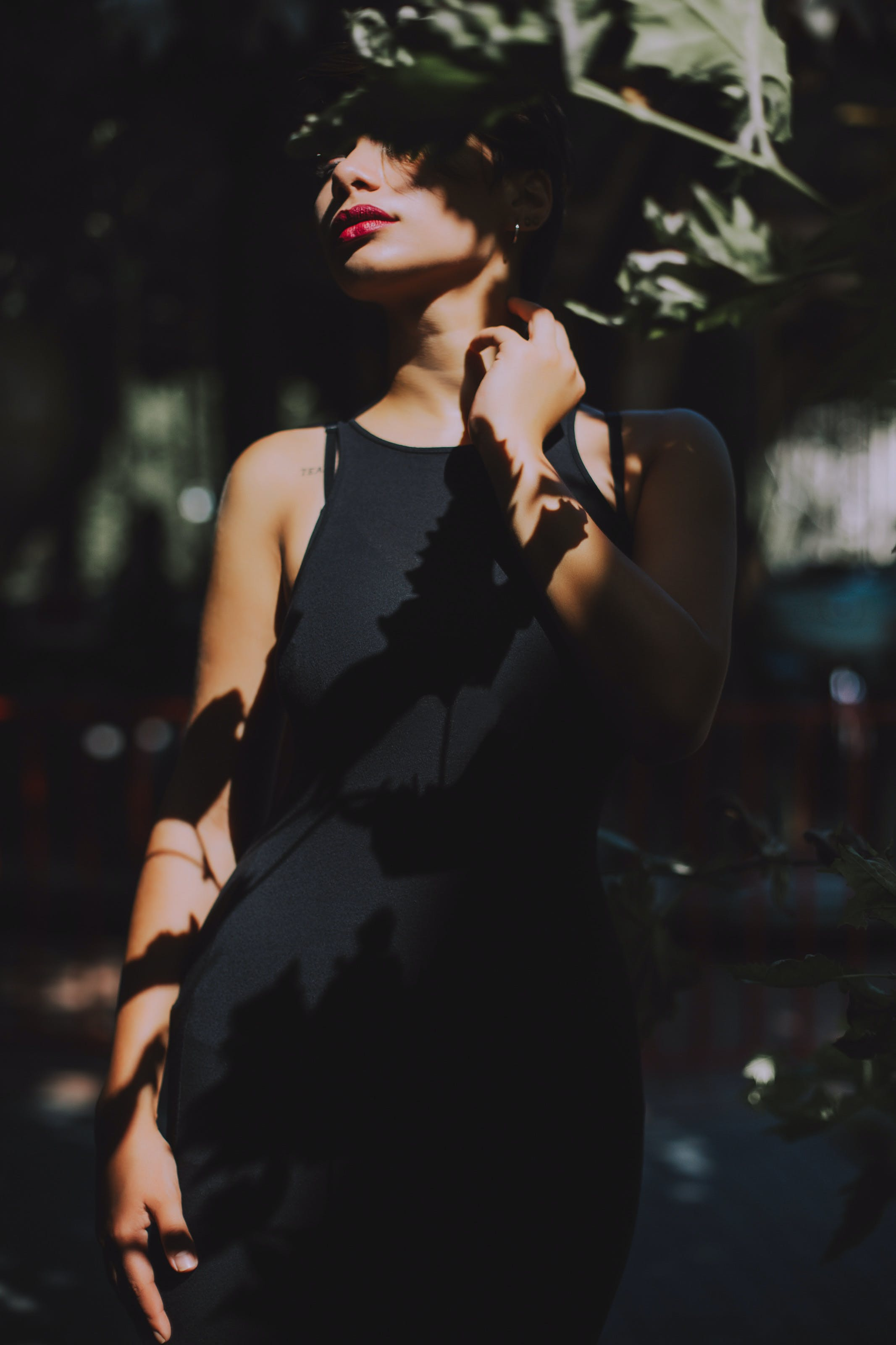 Woman Wearing Black Sleeveless Top Dress Under the Tree