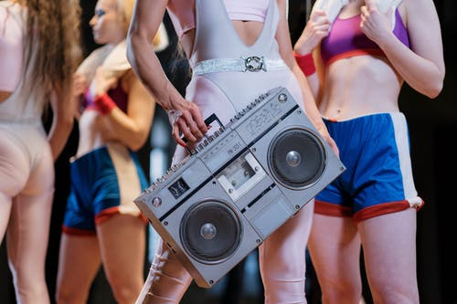 Close-Up Shot of a Person Holding a Boombox