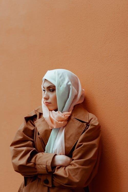 Woman in Brown Coat Wearing White Hijab