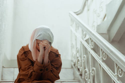 Person in White Hijab Covering Face
