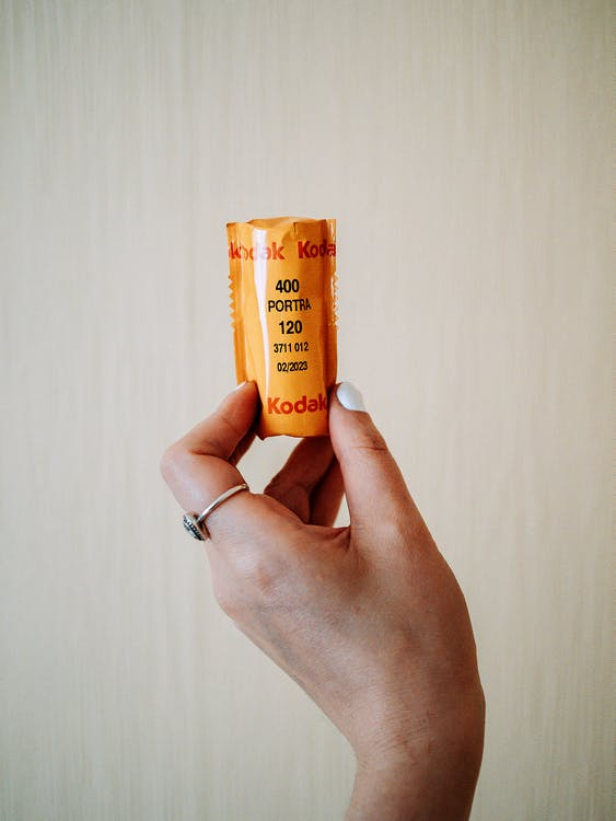 Person Holding Yellow Plastic Tube Bottle