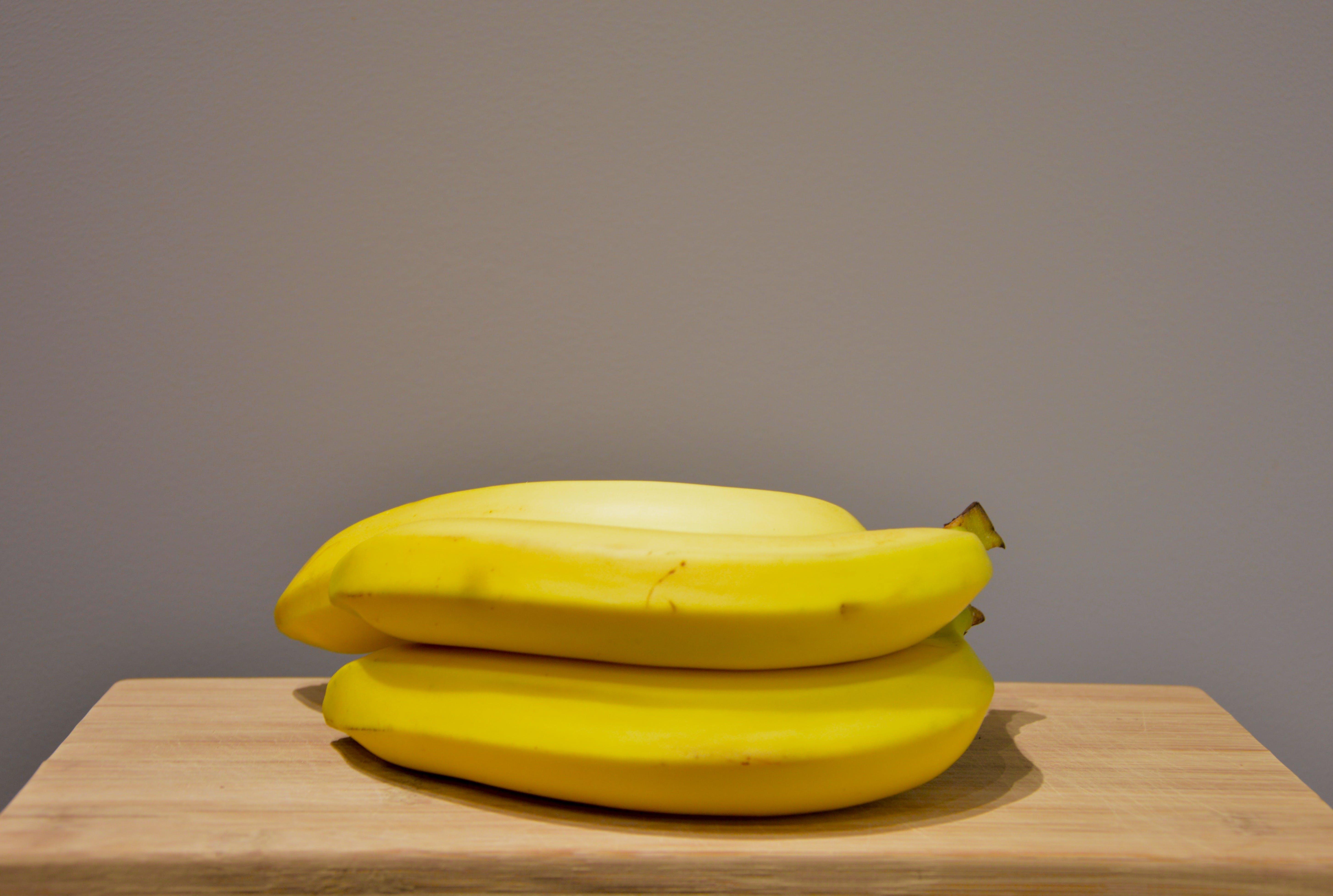 Yellow Bananas on an Oak Wood Table