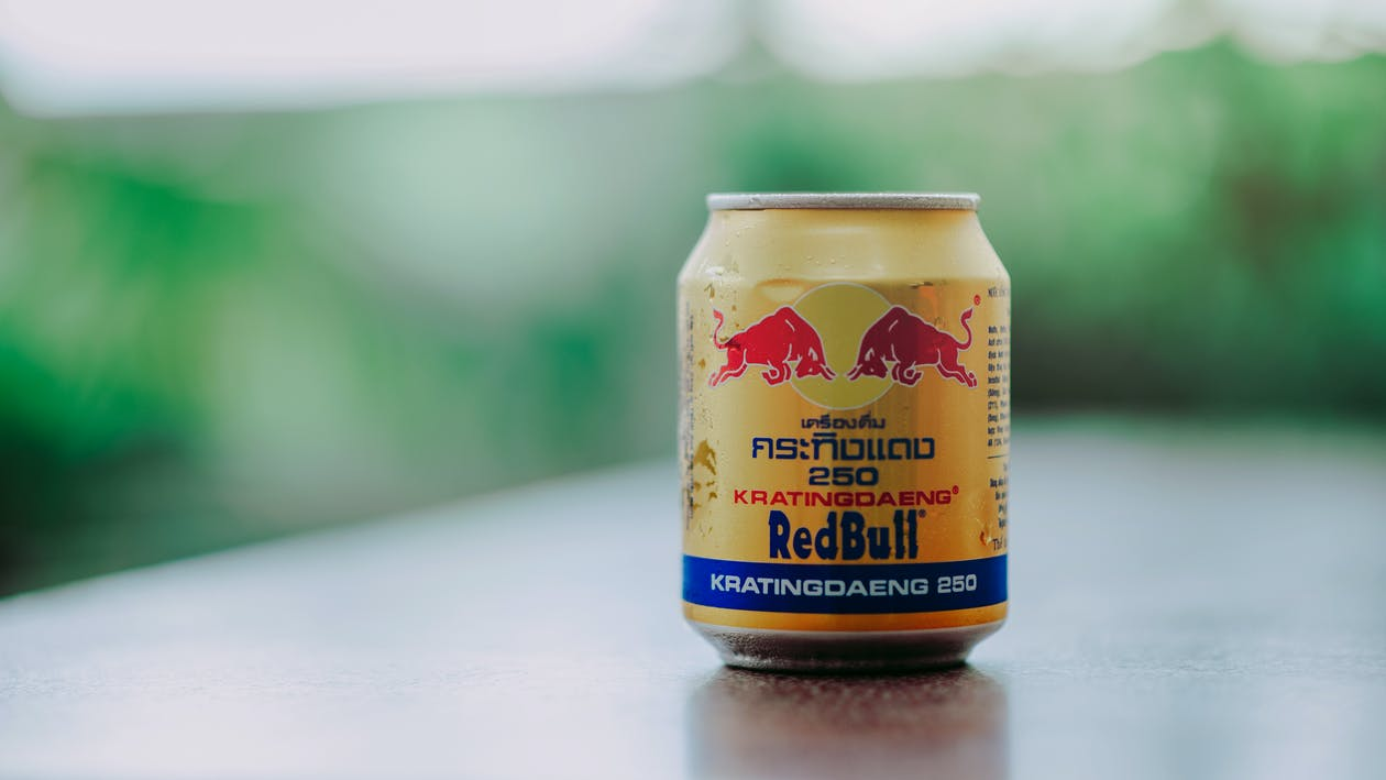 Close-up Photography of Red Bull in Can