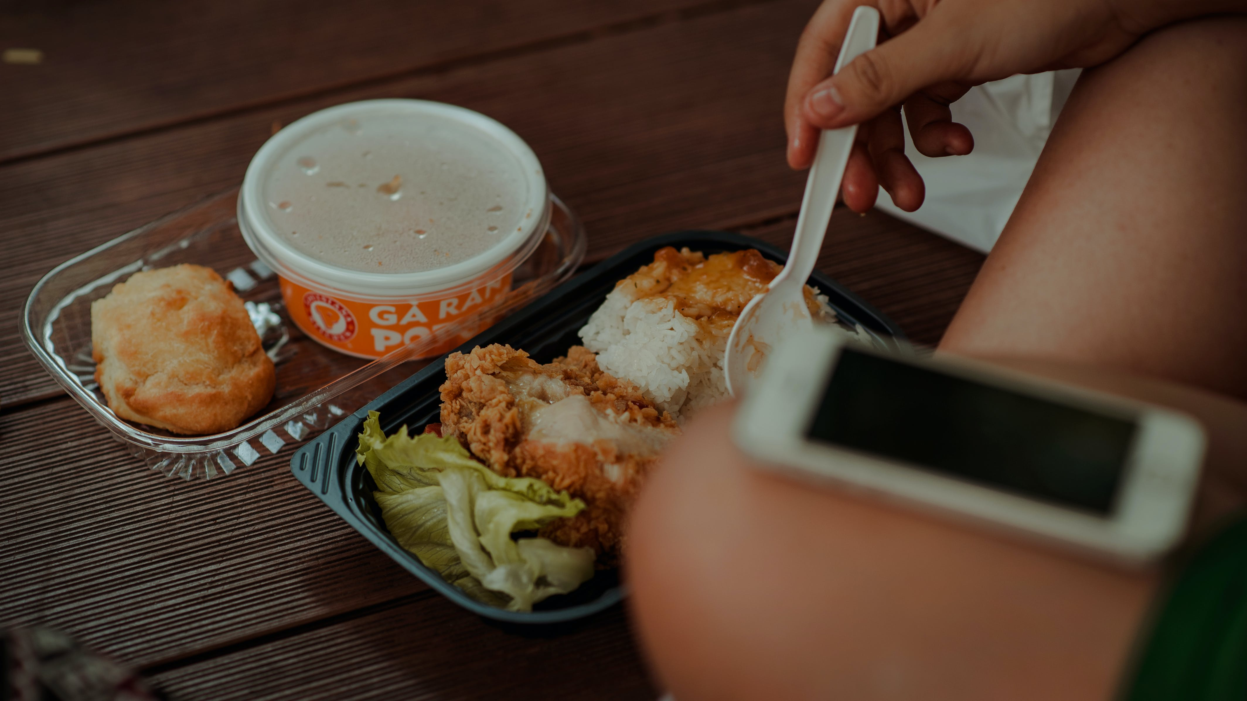 Person Holding White Disposable Spoon Eating Fried Chicken