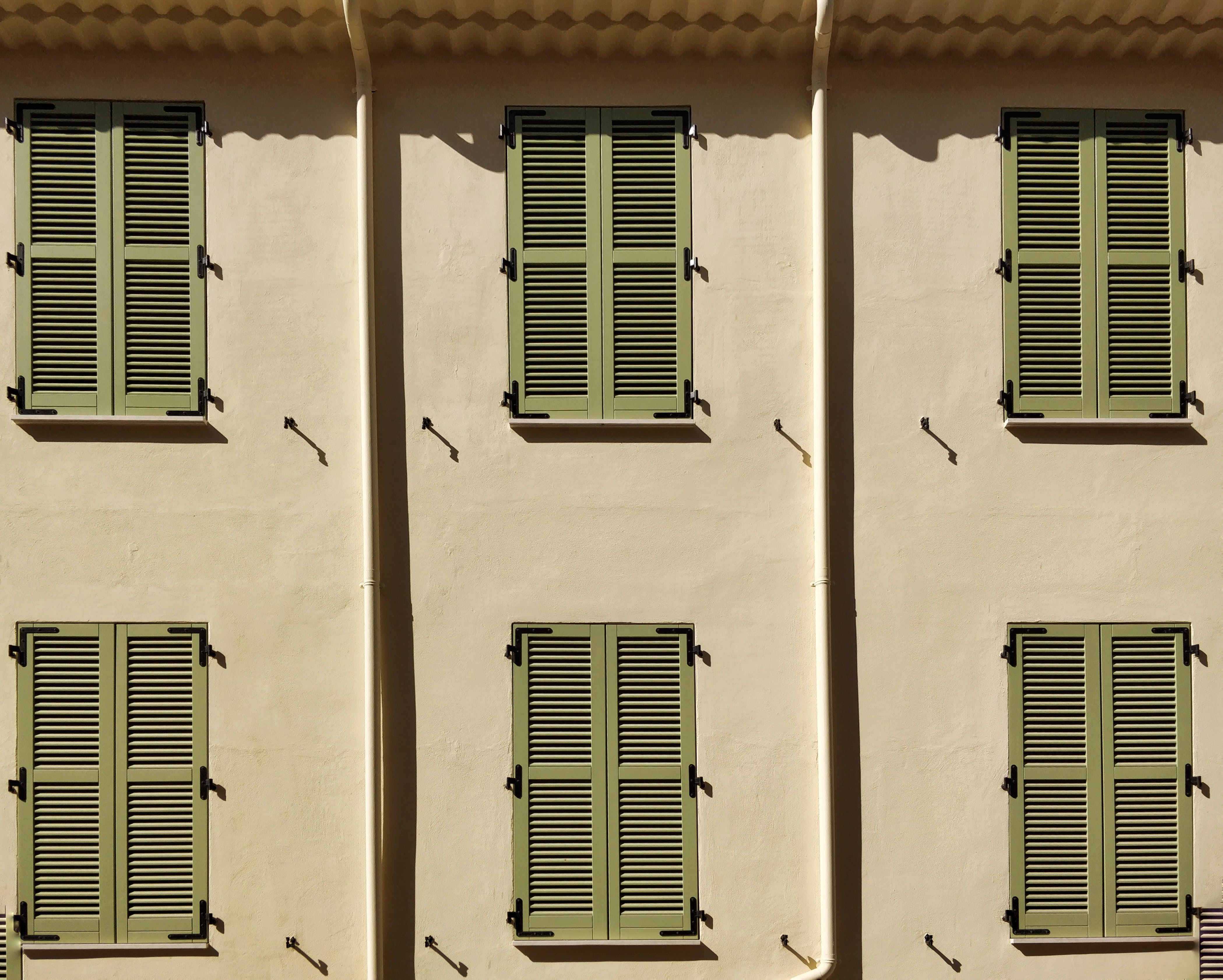 Free stock photo of Cannes, contrast, facade, green