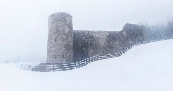 Gray Castle on Snowy Place