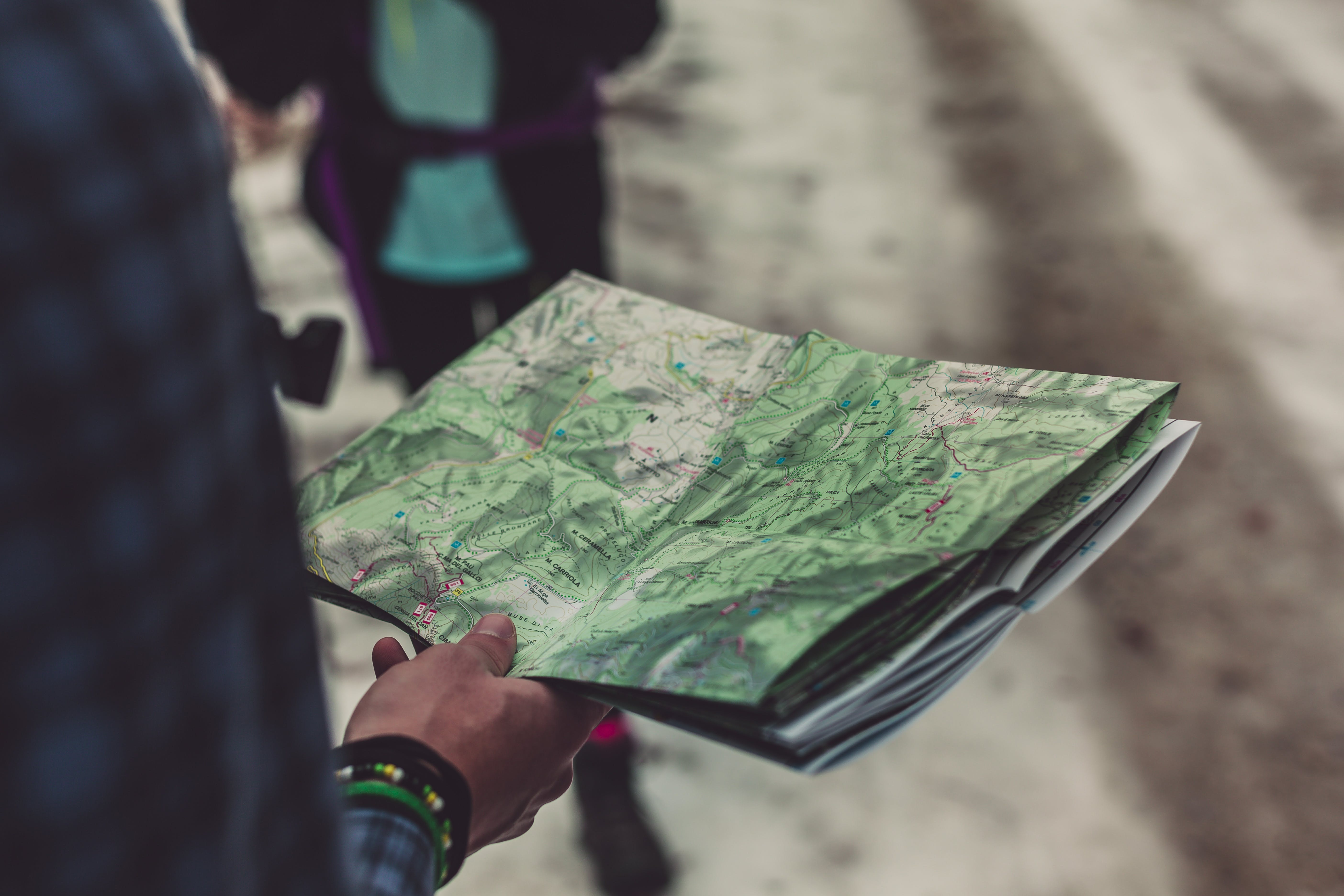 Person Holding Outlined Map