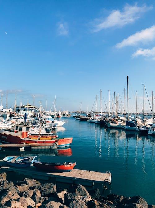 Boats on Dock Under Blue Sky