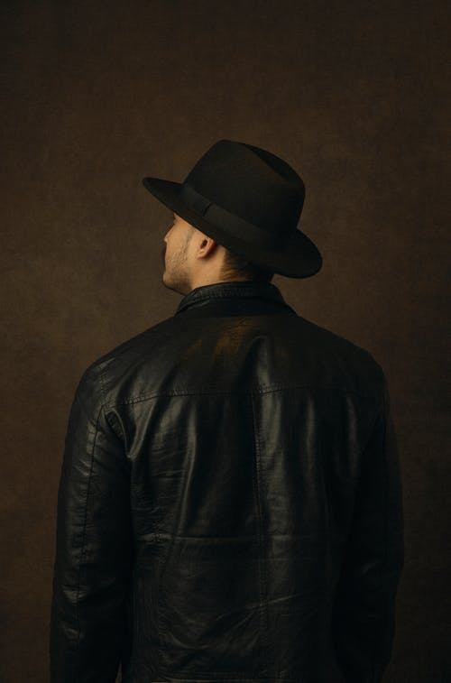 Man in Black Leather Jacket and Black Hat