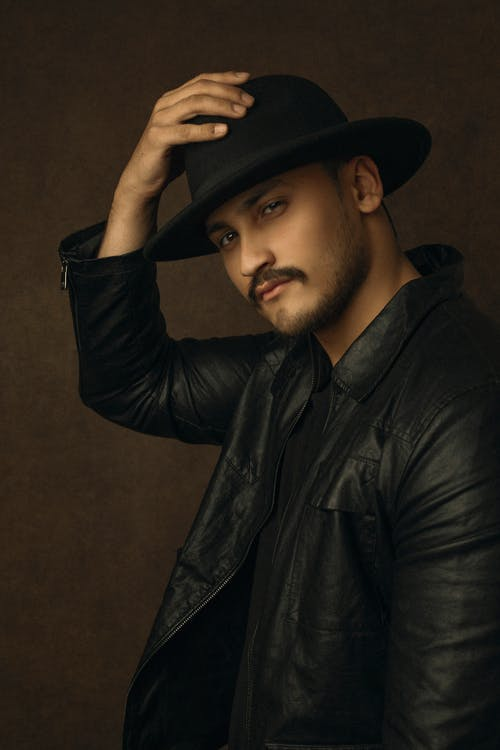 Man in Black Leather Jacket Wearing Black Fedora Hat