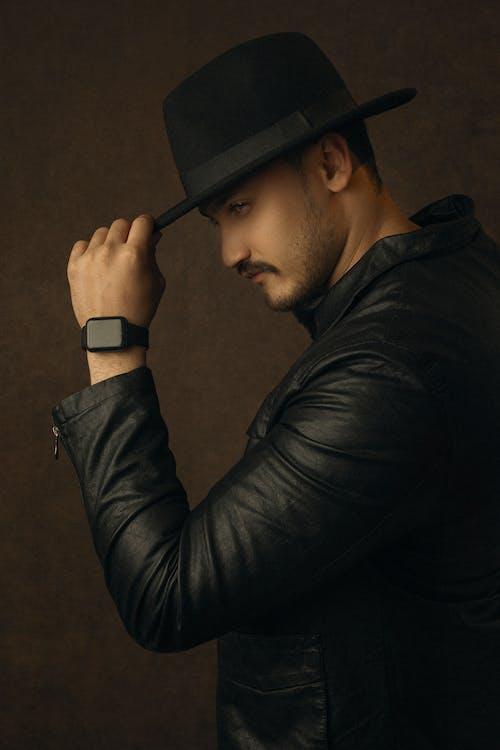 Man in Black Long Sleeve Shirt Wearing Black Cap
