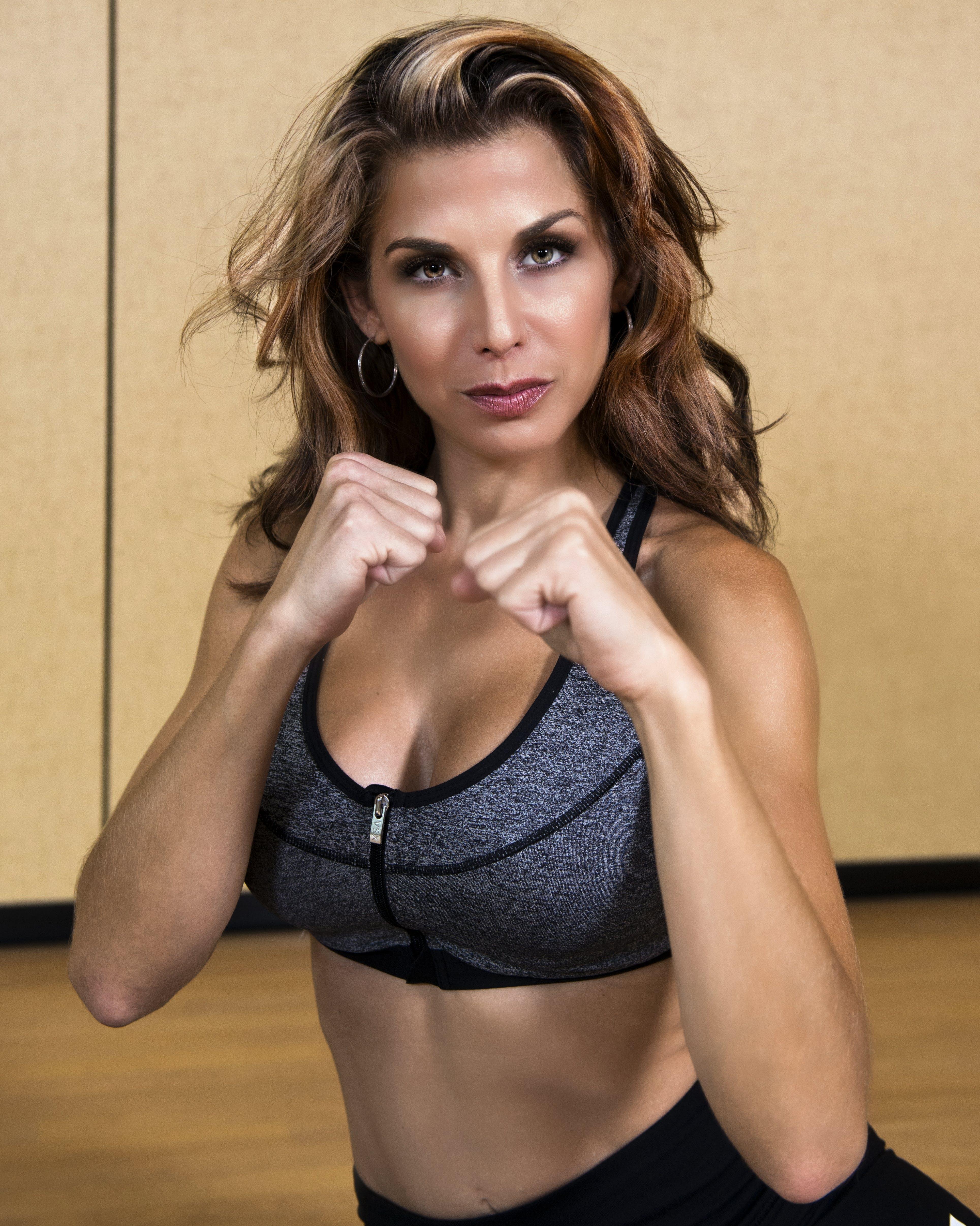 Woman Wearing Gray and Black Sports Bra