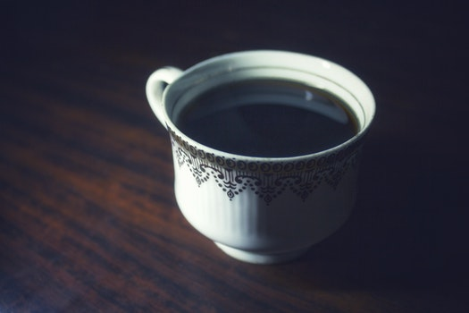 Coffee Served in White Teacup on Brown Wooden Surface