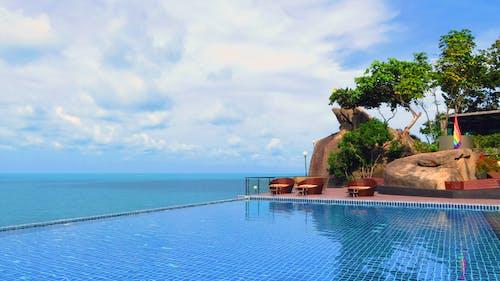 Free stock photo of infinity pool swiiming pool, island, skymoon