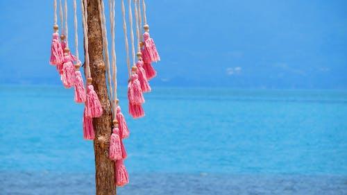 Free stock photo of beach, tassles, wind chime