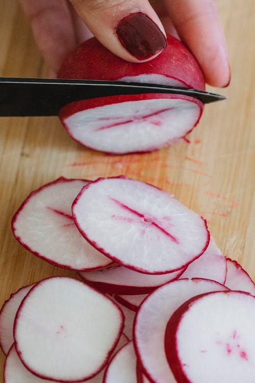 Sliced Cucumber on Brown Wooden Table