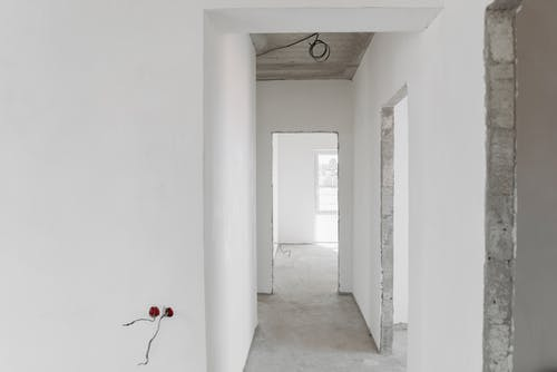 Interior of Unfinished Building with White Paint