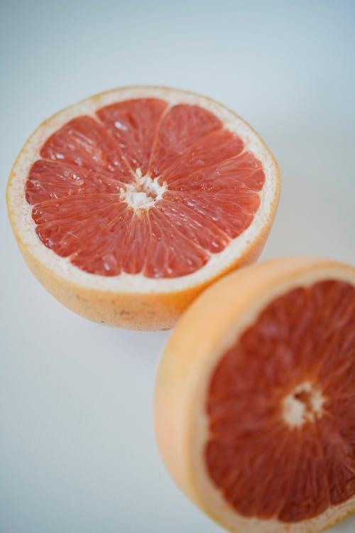 Sliced Grapefruit on White Surface