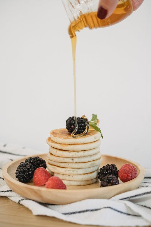 Syrup Pouring on Stack of Pancakes