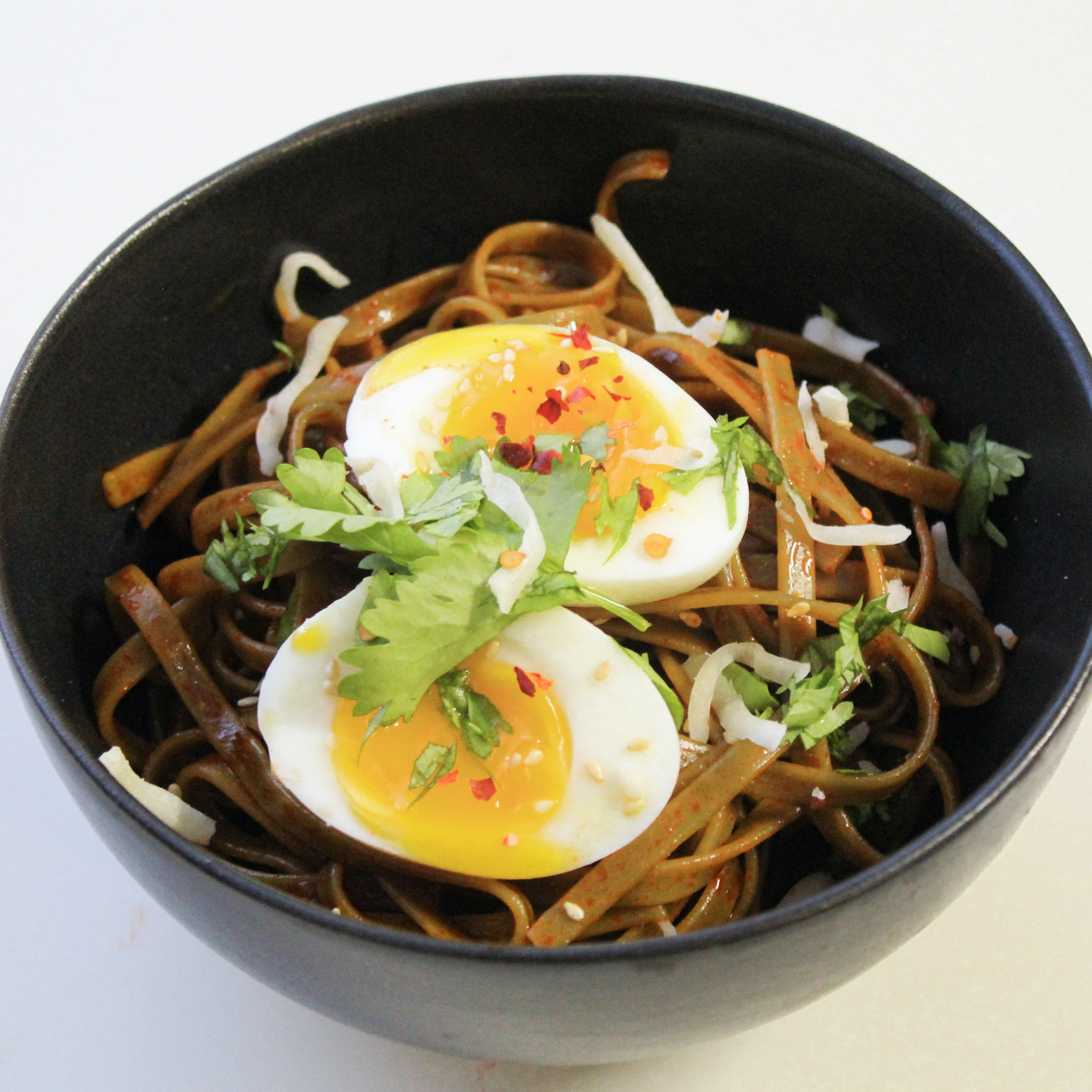 Bowl Filled With Noodles and Hard Boiled Egg