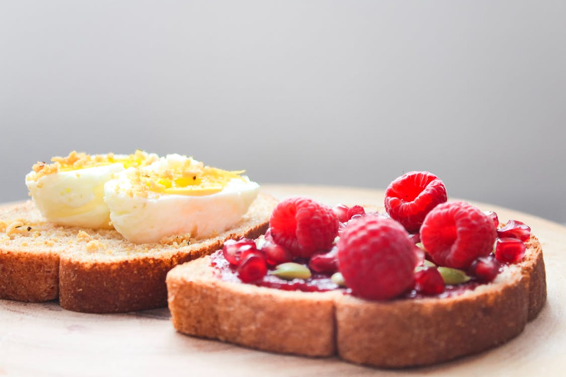 Two Boiled Egg and Raspberries on Loaf Bread