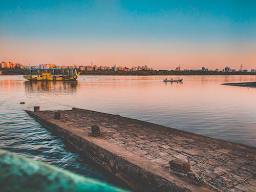 Бесплатное стоковое фото с pov, вечер, вечернее небо, вода