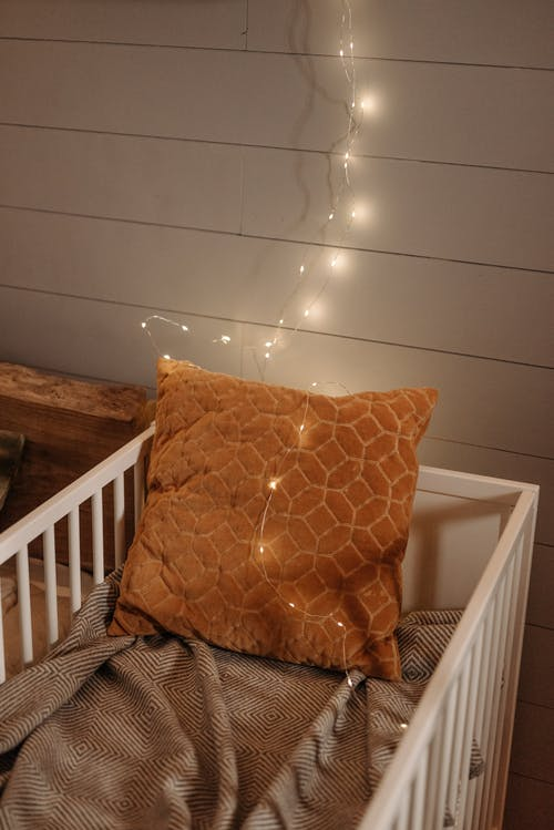 String Lights on Brown Throw Pillow