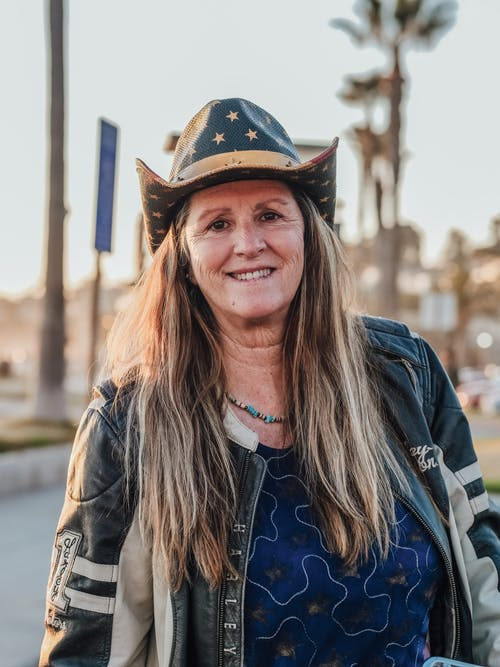 Woman in Black Leather Jacket and Black Cowboy Hat