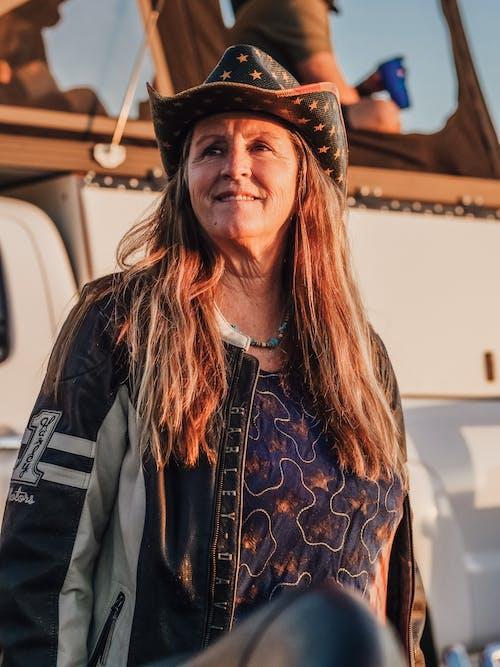 Woman in Black Leather Jacket Wearing Black Hat