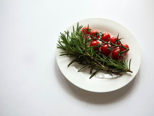 Red and Green Chili on White Ceramic Plate