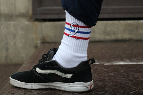 Foot with White Sock and Black Sneaker
