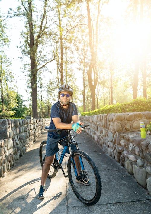 Man in Black T-shirt Riding Black Bicycle