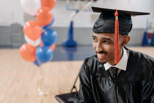 Close Up Photo of Man Wearing Academic Cap