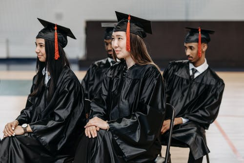 Photo of People in Black Academic Gown