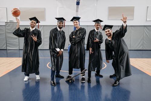 Photo of Men in Black Graduation Gown