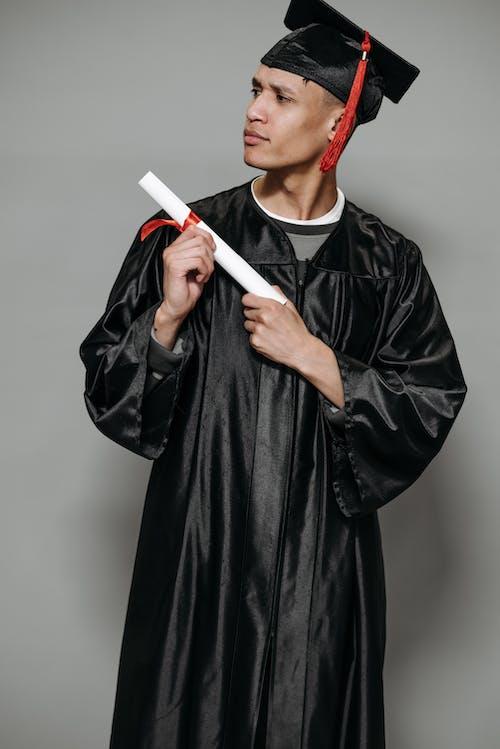 Photo of Goofy Man Holding Diploma