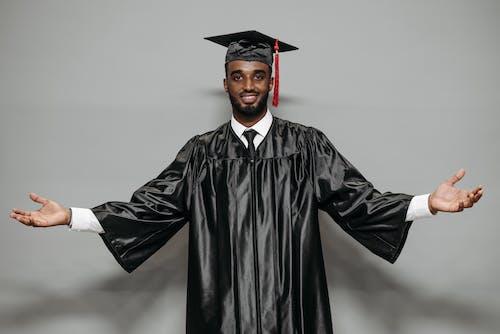 Photo of Man in Black Academic Dress