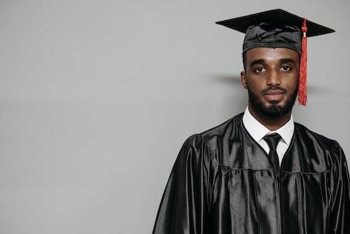 Photo of Man Wearing Black Graduation Gown