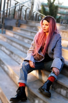 Woman With Pink Long Hair Sitting