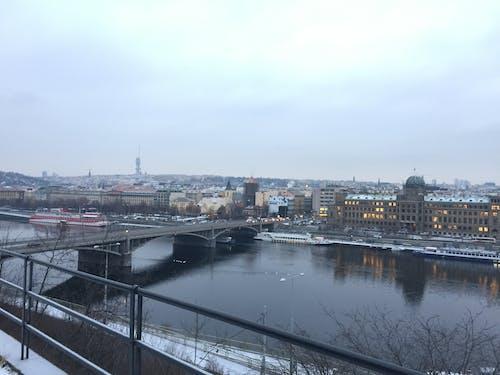 Free stock photo of bridge, city skyline, grey sky