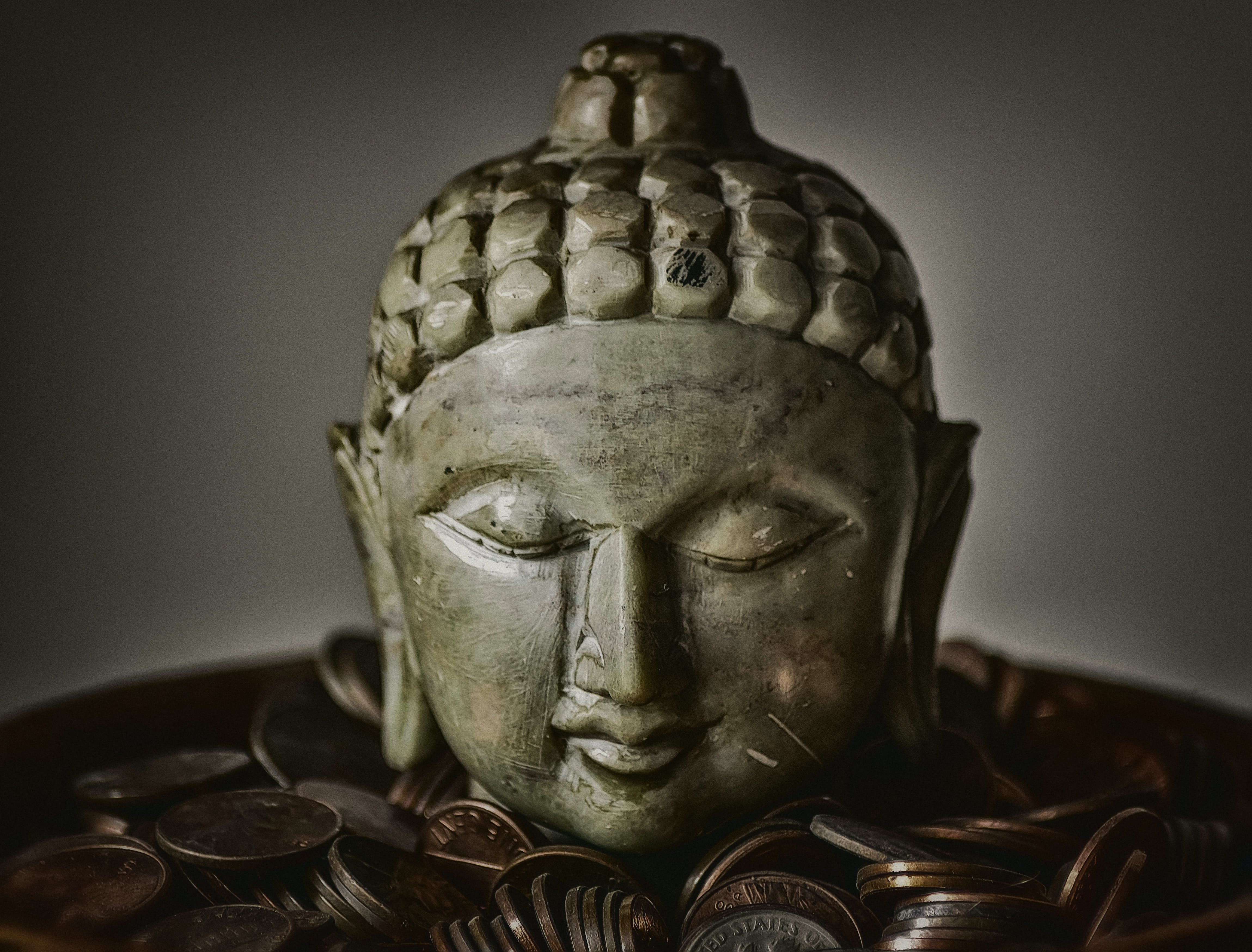 Gautama Buddha Bust Surrounded by Coins
