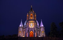 Gray and White Concrete Cathedral With Lights Photo