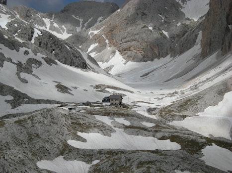 Beige 2-storey House on Snow Mountain