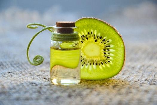 Kiwi Beside Glass Bottle
