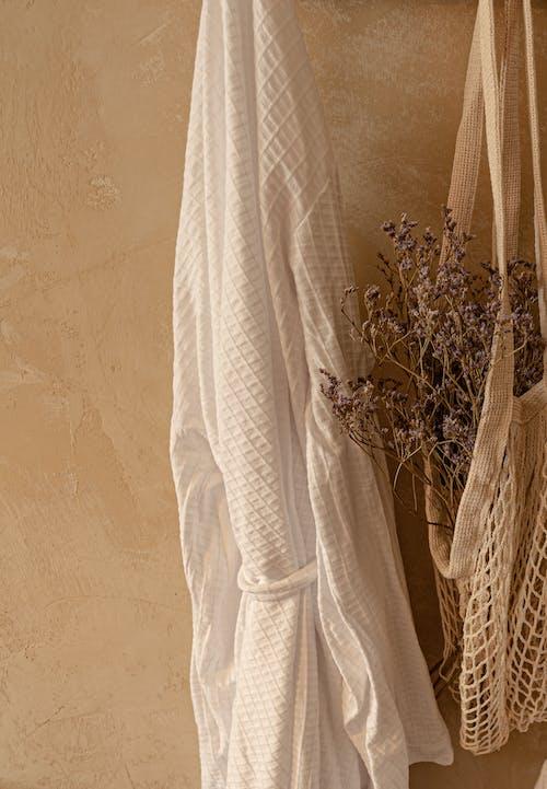 White Long Sleeve Shirt Hanged on White Wall