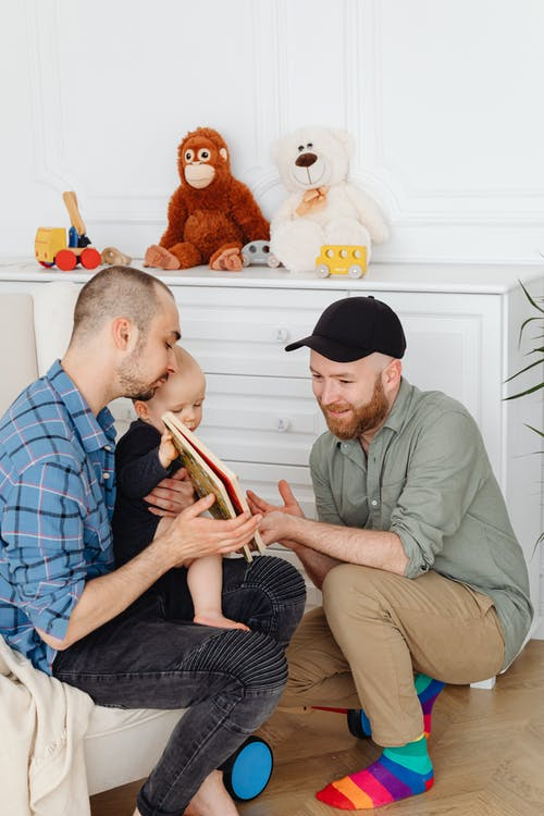 Two Men Bonding With A Baby
