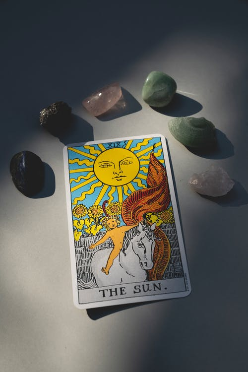 Tarot Card Surrounded with Healing Stones